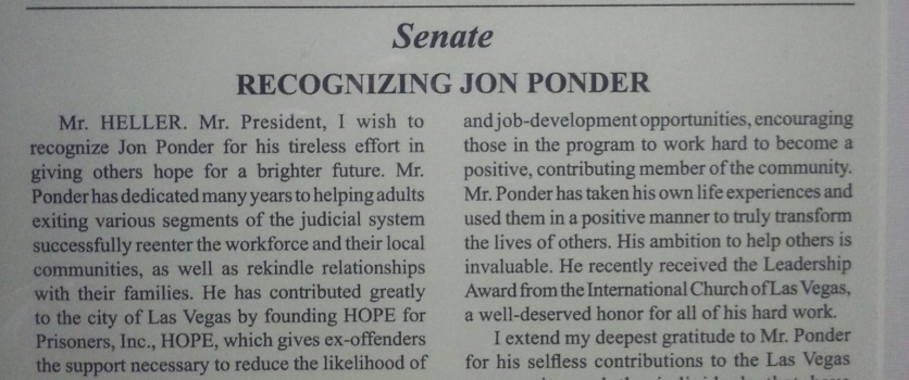 Jon D. Ponder receives a Congressional Record from U.S. Senator Dean Heller